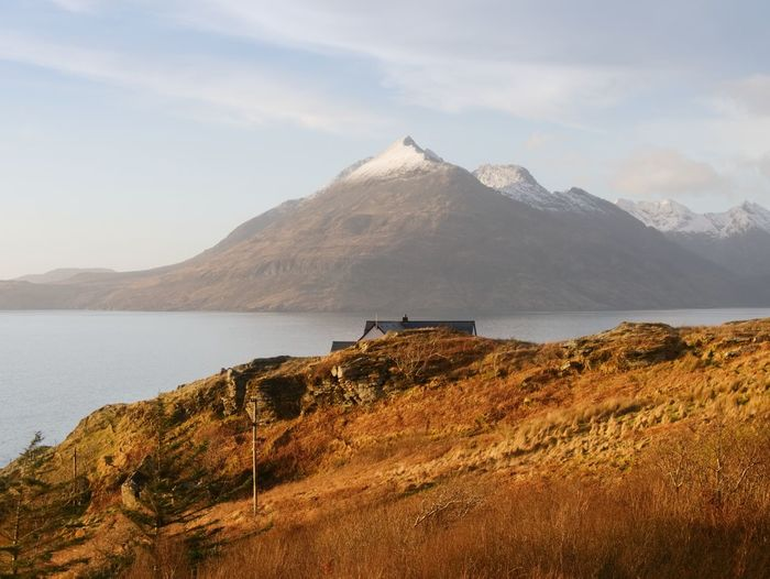 Evening at loch scavaig with cuillins mountains in warm sunset light. isle of skye scotland