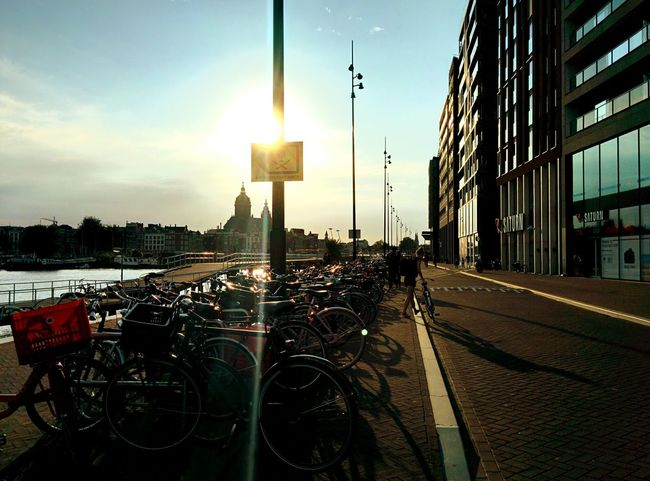 Travel City Transportation Sky Outdoors Business Finance And Industry No People Cityscape Day Amsterdam Travel Vacations Green Color Looking Through Window Relaxation Travel Destinations Cityscape Beauty In Nature Scenics Landscape Tranquility Autumn Illuminated Cultures Cloud