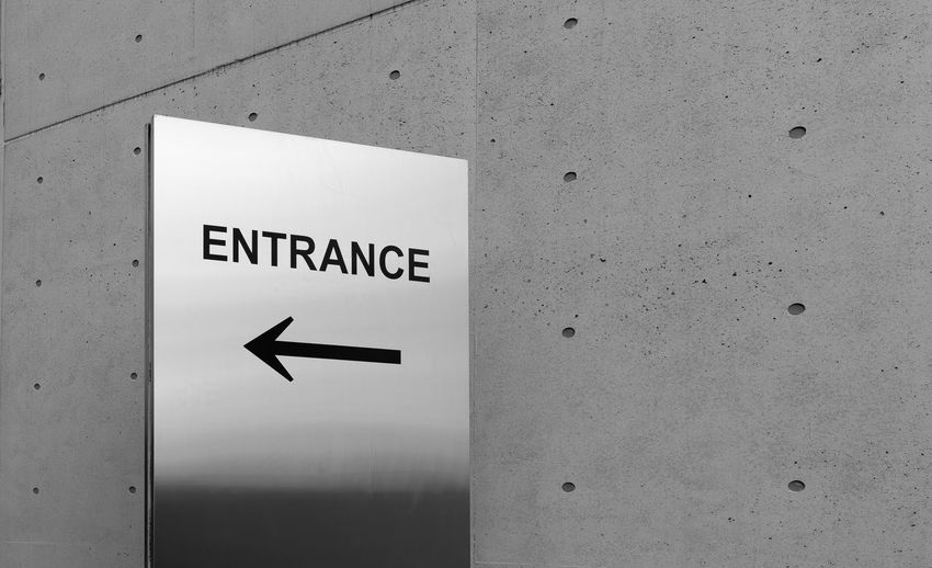 Communication Text Sign Western Script Wall - Building Feature Arrow Symbol Guidance Symbol No People Directional Sign Direction Wall Indoors  Close-up Information Built Structure Architecture White Color Exit Sign Arrow