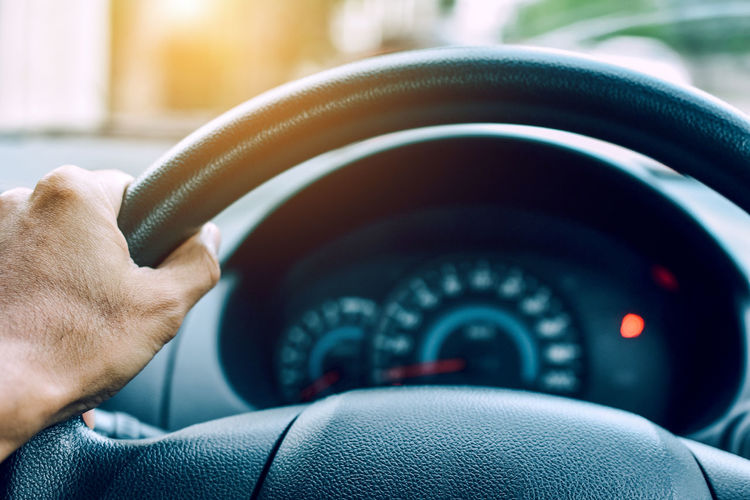 Man driving car on road transportation highway road Car Car Interior Close-up Control Finger Focus On Foreground Hand Holding Human Body Part Human Finger Human Hand Mode Of Transportation Motor Vehicle Number One Person Real People Steering Wheel Transportation Vehicle Interior