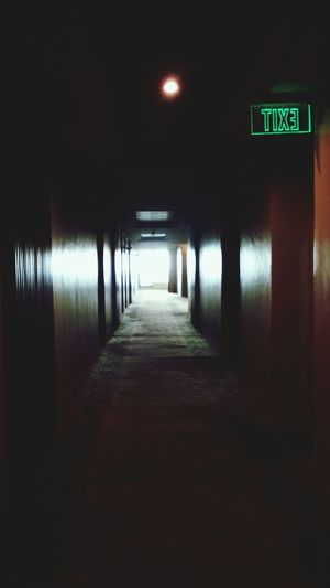 Run faster! || Hotel Creepy Hallway Dark American Horror Story Feels Exit Sign The Way Forward Run Scared No Filter No People Illuminated Day Indoors