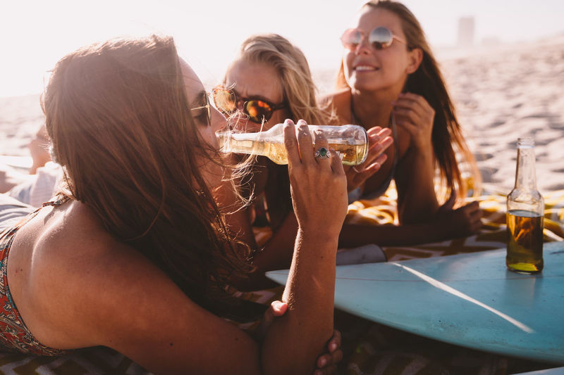 Alcohol Drink Refreshment Food And Drink Friendship Leisure Activity Lifestyles Happiness Real People Drinking Young Adult Togetherness Smiling Sitting Nature Women Glass Enjoyment Group Of People Outdoors