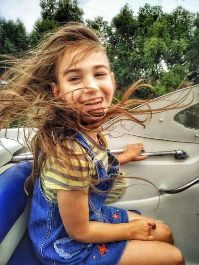 Portrait of smiling girl in car