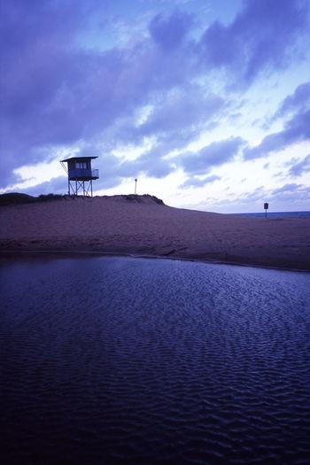 silhouette of a life guard hut after sunset Beach Beach Resuce Cloud - Sky Coastline Hut Life Guard Life Saver Lifeguard  Lookout Outdoors Rescue Hut Sand Scenics Shore Silhouette Sky Skydusk Sunset Tower
