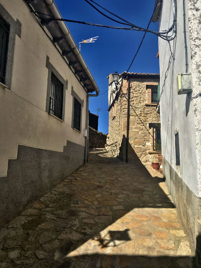 Architecture Built Structure Building Exterior Building Direction Sky The Way Forward Residential District Sunlight Shadow Nature Window Wall No People Day City House Narrow Footpath Blue Outdoors Alley Stone Wall