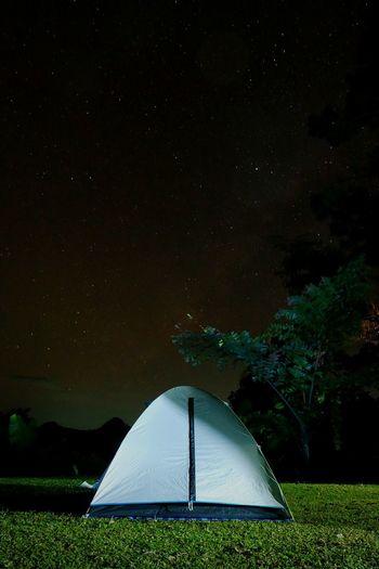Tent On Grassy Field Against Star Field