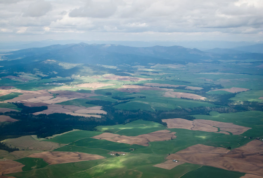 Aerial View Agriculture Beauty In Nature Cloud Cloud - Sky Crop  Cultivated Land Day Dramatic Landscape Farm Green Color High Angle View Landscape Majestic Mountain Nature Non-urban Scene Patchwork Landscape Rural Scene Scenics Sky Tranquil Scene Tranquility Travel Destinations Wide Shot