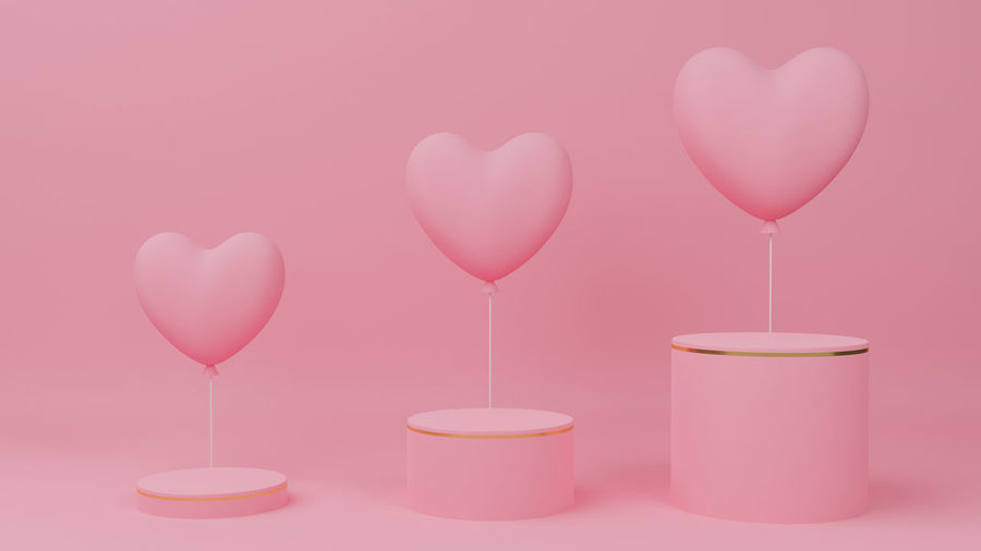 Close-up of pink heart shape over white background