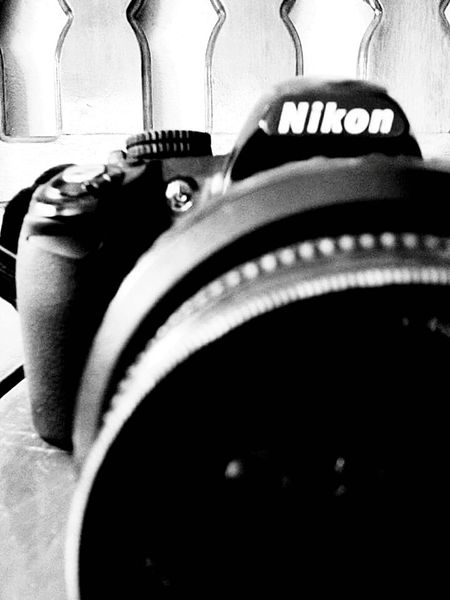 Nikon Camera. Black and white Camera - Photographic Equipment Photography Themes
