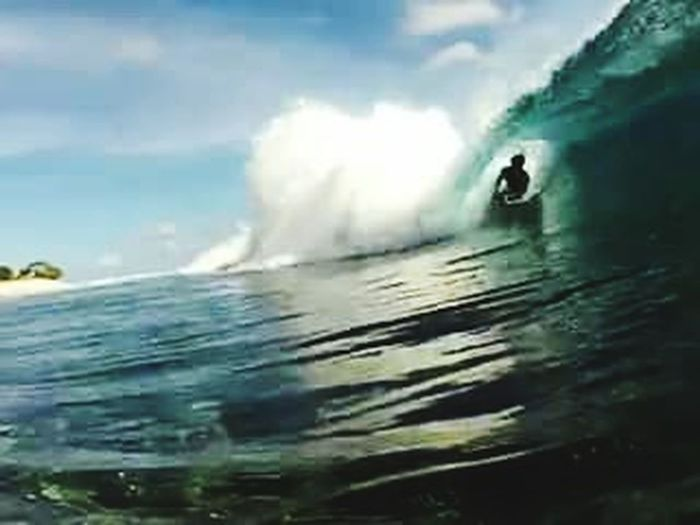 My favorite sport. Surfing on the wave hello world Apataki