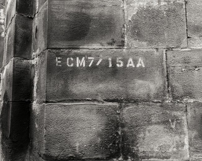 Code on stone Stone Old EyeEm Gallery EyeEmNewHere EyeEm Best Shots Concrete Wall Urban Urbanphotography Urban Landscape Urban Photography Backgrounds Textured  Full Frame Close-up Weathered Capital Letter Information Information Sign Deterioration