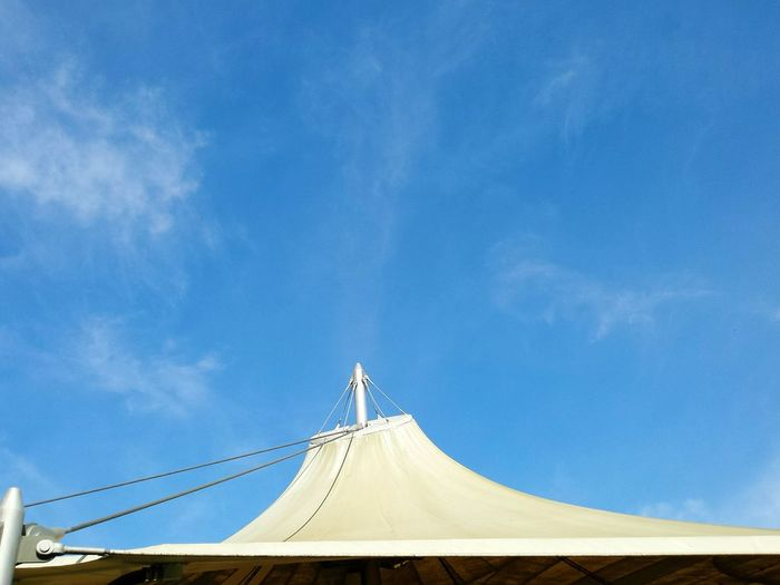Low Angle View Of Circus Tent Against Blue Sky During Sunny Day