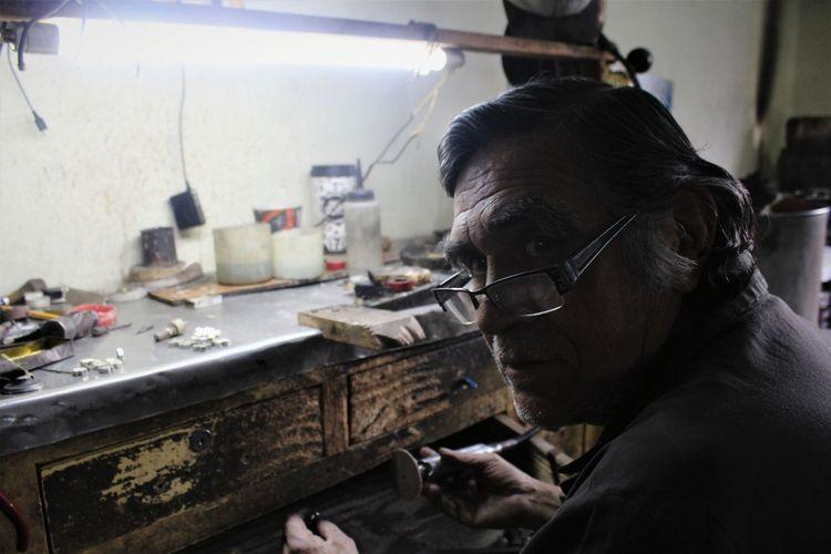 Portrait of manual worker working in factory