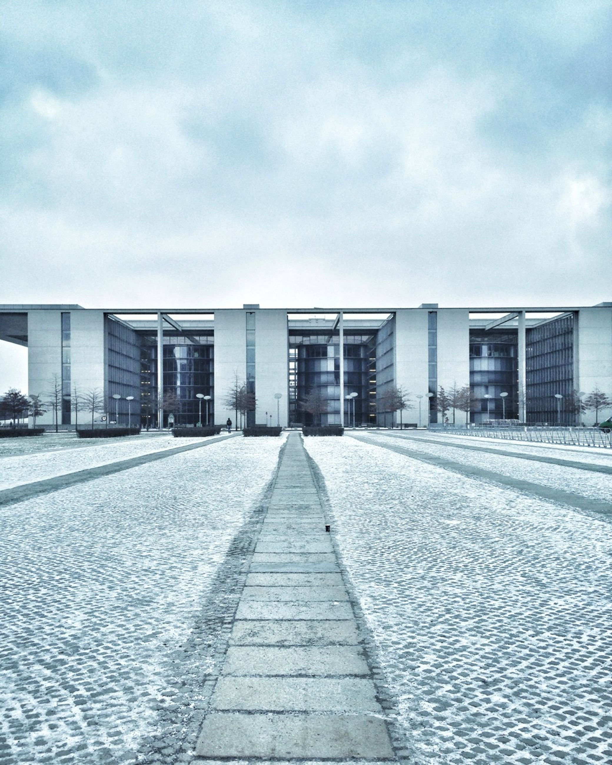 the way forward, sky, diminishing perspective, architecture, built structure, vanishing point, cloud - sky, empty, building exterior, long, cloud, walkway, cloudy, day, cobblestone, narrow, in a row, pathway, outdoors, footpath