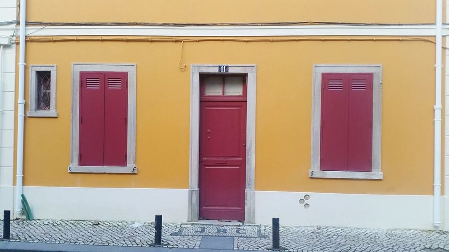 red City Golf Club Multi Colored Yellow Pastel Colored Façade Window Door Building Exterior Architecture Historic Shutter History Front Door