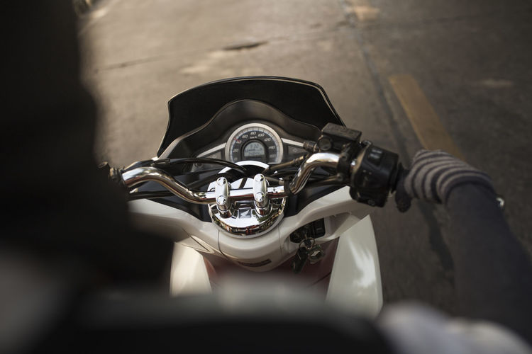 Cropped Image Of Person On Scooter
