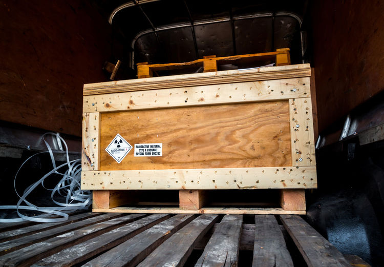 Radioactive material label beside the transportation wooden box type a standard package in the truck