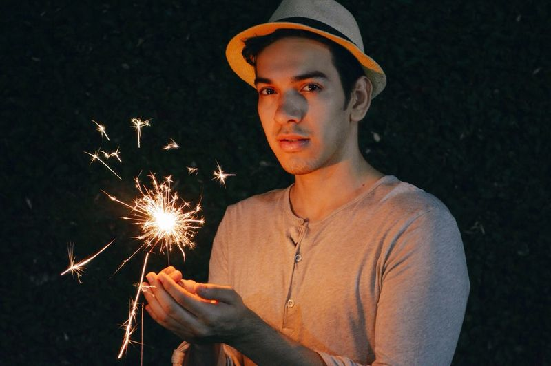 Let the spark of 2017 begin! 🎆 Night One Person Standing Portrait Young Adult Lifestyles Headshot Holding Real People People Illuminated Folk Long Exposure Celebration Hipster Lights Cool Boy Hat Sparks Sparkler Fireworks New Year Firework Display