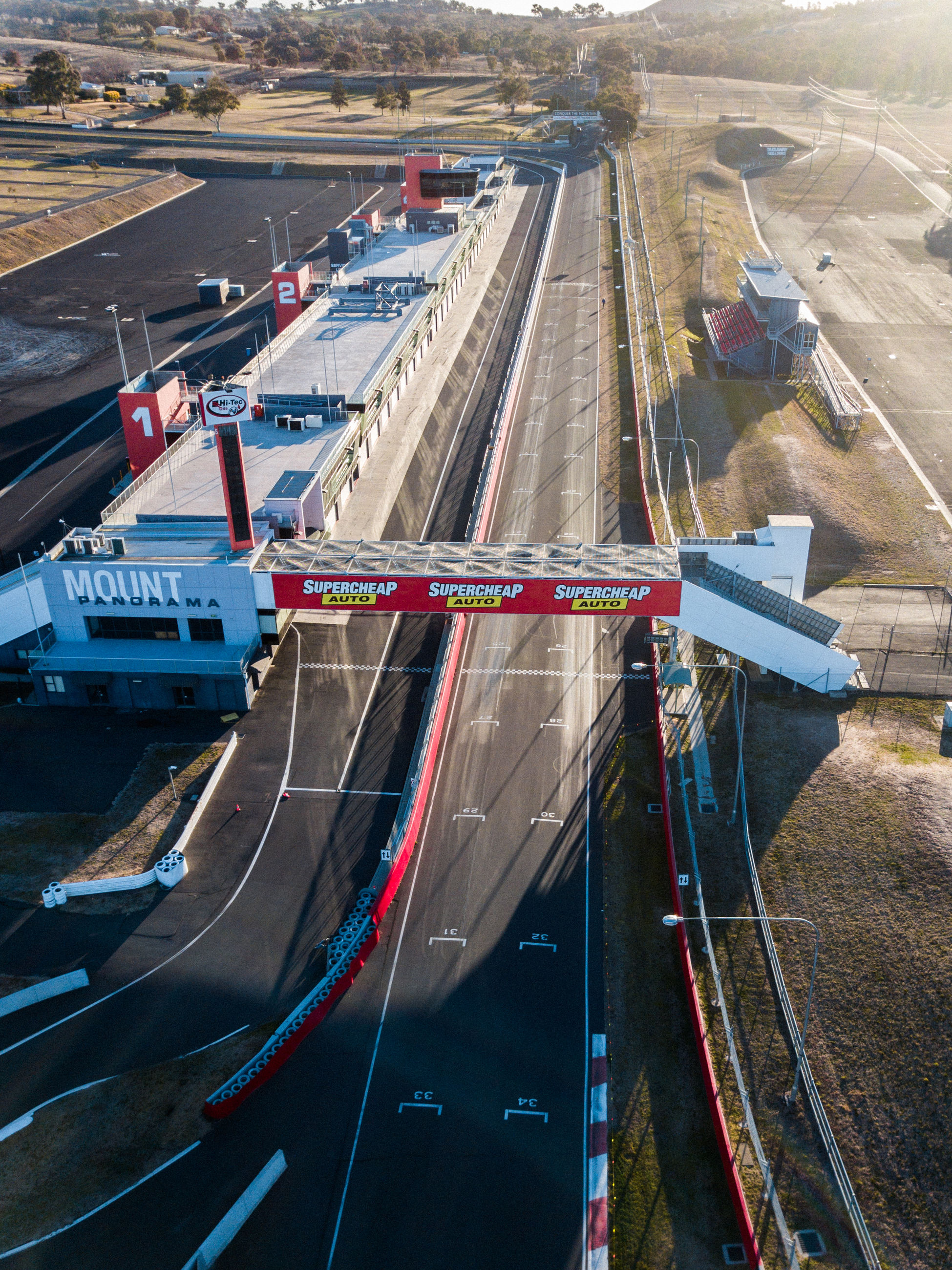 transportation, high angle view, mode of transportation, day, nature, road, outdoors, no people, industry, airport runway, architecture, water, public transportation, land vehicle, symbol, motion, sunlight, sign, city, travel