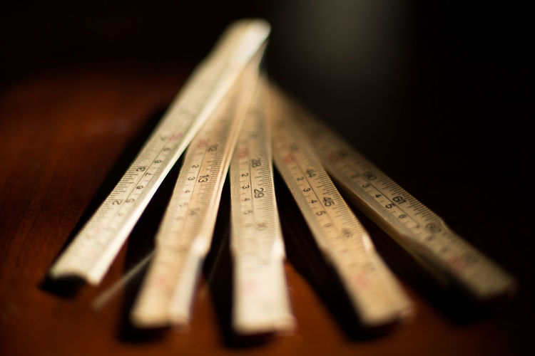 High angle view of wooden folding ruler on table