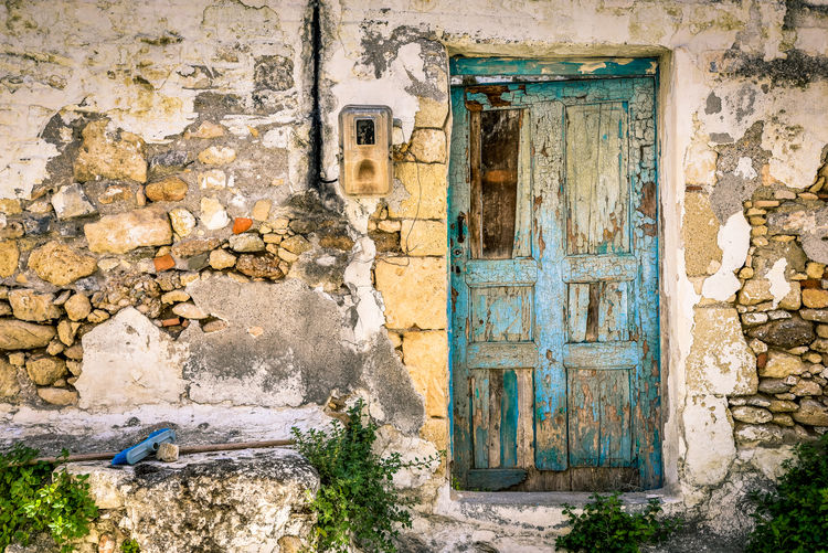 Attraction of Unsophistication By Anna Wacker Architecture Old Abandoned Door Ruined Building Entrance Day House History Outdoors The Past Weathered Abandoned & Derelict Closed Stone Wall Damaged Decline No People Decayed Beauty Deterioration Building Exterior Built Structure Wall - Building Feature Run-down