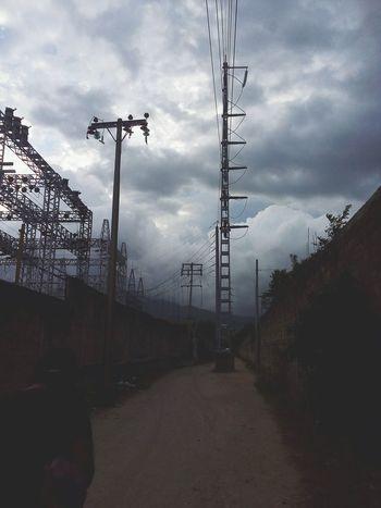 Infiniti Electricity Pylon Telephone Line Electricity  Human Hand Human Leg Electricity  Nature No People Day Fragility