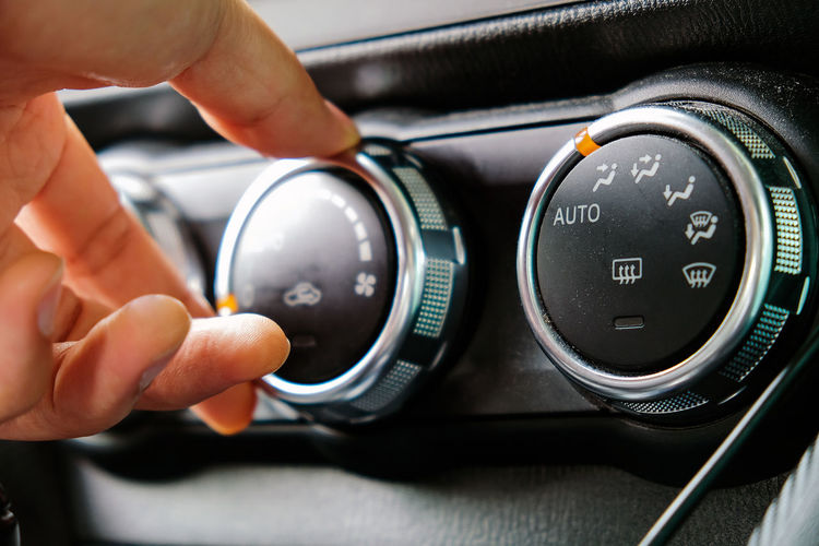 Close-up of hand holding camera in car