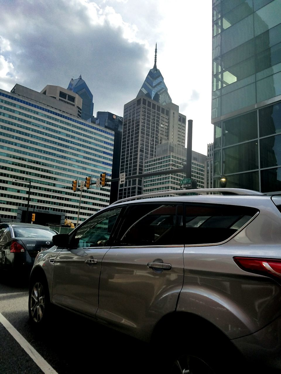 car, architecture, building exterior, built structure, city, skyscraper, transportation, modern, mode of transport, sky, land vehicle, day, outdoors, growth, no people, cityscape