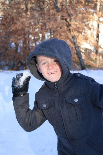 Cold Temperature Winter Warm Clothing Knit Hat One Person Glove Child Portrait Smiling Snow Outdoors Snowing Snowball Happy Child  EyeEm Nature Lover Winter Sport Playing In The Snow Cute Missing Tooth