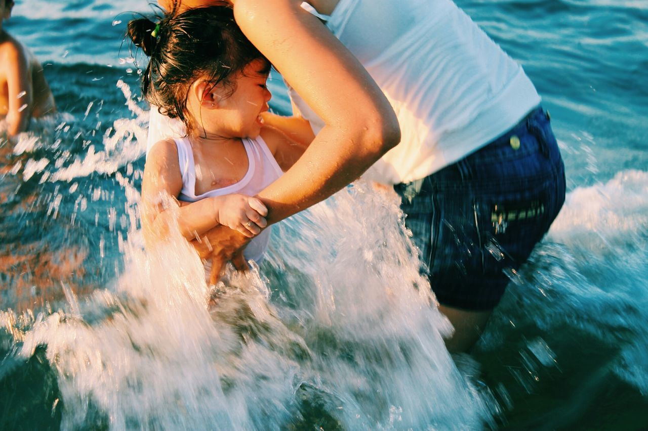 water, real people, childhood, motion, leisure activity, two people, fun, girls, lifestyles, wet, happiness, elementary age, boys, day, outdoors, sea, nature, swimming, people