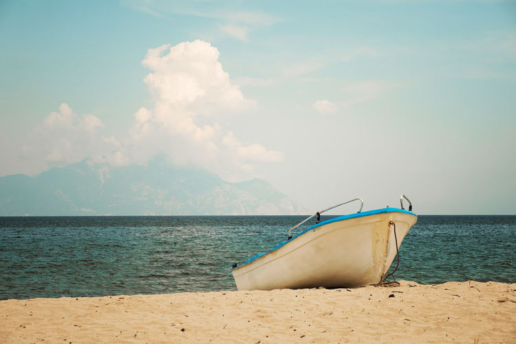 Boat on the shore Beach Beauty In Nature Boat Day Greece Horizon Over Water Landscape Landscape_Collection Nautical Vessel No People Outdoors Sand Scenics Sea Sky Summer Tranquility Travel Destinations Tropical Tropical Paradise Water