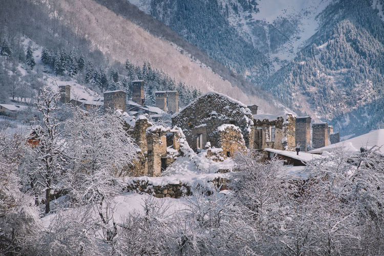 Snow Cold Temperature Winter Architecture Mountain Built Structure Building Exterior Nature Building Tree No People Snowing Scenics - Nature Frozen Plant Landscape Beauty In Nature Environment Day Outdoors Snowcapped Mountain Extreme Weather Blizzard Mestia Old Village