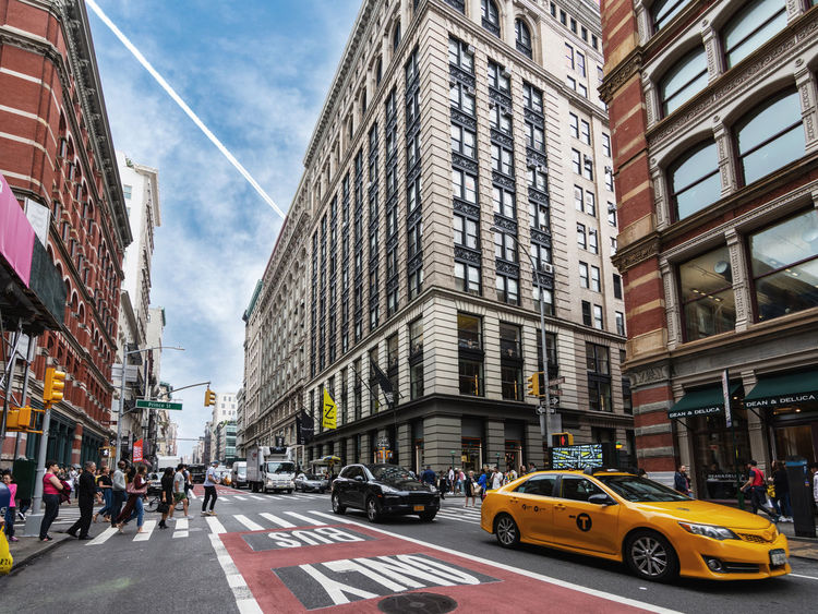 Urban SOHO Life Taxi Low Angle View NYC NYC Street Photography SoHo #nyc Taxi Architecture Building Building Exterior Built Structure City Life City Street Crossing Crosswalk Group Of People Mode Of Transportation Office Building Exterior Road Road Marking Street Transportation Urban Zebra Crossing
