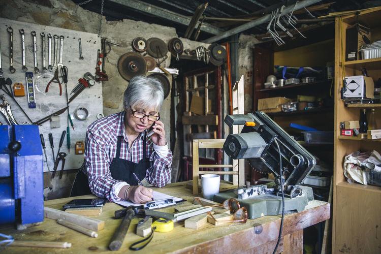 Senior woman working at workshop