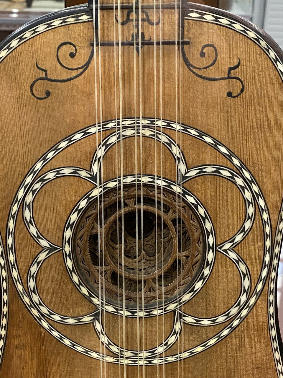 no people, wood - material, brown, indoors, close-up, circle, geometric shape, arts culture and entertainment, musical instrument, pattern, musical equipment, high angle view, music, musical instrument string, shape, string instrument, spiral, skill, guitar, single object