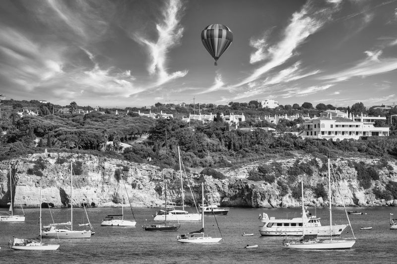 View of hot air balloon over sea against sky