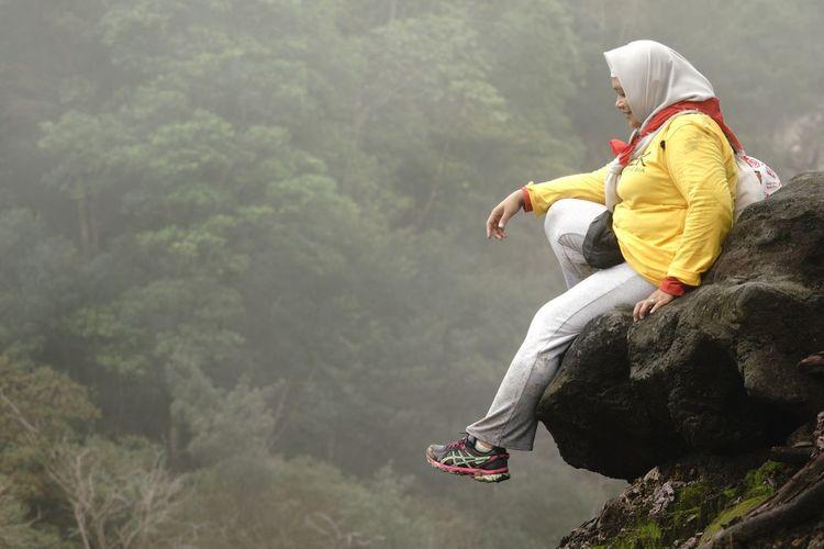 Sitting down at the edge of cliff at kawah mati (dead crater) Gunung Salak Kawah Ratu Kawah Mati Real People One Person Day Rear View Men Outdoors Leisure Activity Nature Fog An Eye For Travel