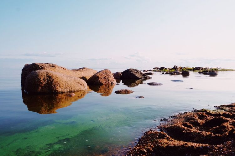 Stones and water, 30.07.2018, Saint-Petersburg, green water. Stones & Water Stone Water Last Days Of Summer Last Water Sky Sea Nature Solid Rock Beauty In Nature Rock - Object No People Scenics - Nature Tranquility Copy Space Reflection Outdoors Beach Idyllic Tranquil Scene Day Clear Sky