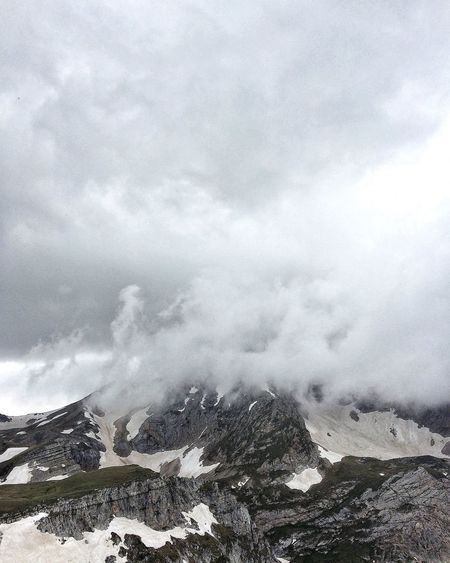 View of clouds over mountain range