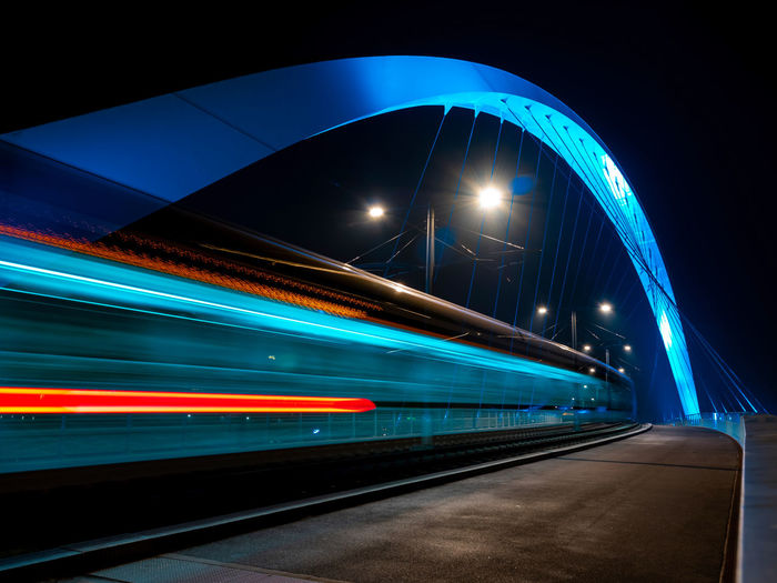 Light trails on train at night
