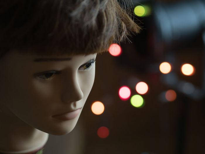 Close-up of doll against illuminate lighting equipment