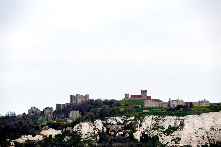 White Cliffs of Dover. Dover Dover, England England, UK United Kingdom Architecture Building Building Exterior Built Structure City Copy Space Day England Environment Land Landscape Nature No People Outdoors Plant Rock Rock - Object Sky Solid Travel Destinations Tree White Cliffs  White Cliffs Of Dover