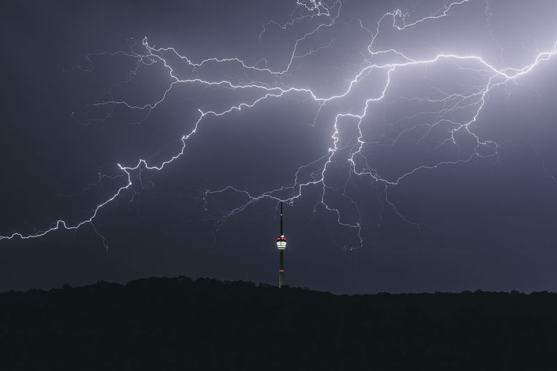 Tv tower at night during a thunderstorm