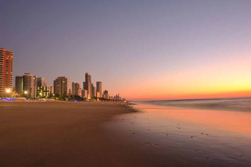 Gold Coast Architecture Beach Building Exterior Built Structure City Cityscape Clear Sky Horizon Over Water Modern No People Outdoors Reflection Sand Scenics Sea Sky Skyscraper Sunset Sunshine Coast Tourism Tranquility Travel Destinations Urban Skyline Vacations