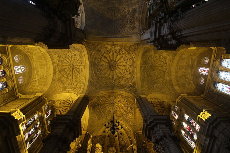 Low angle view of illuminated ceiling of building