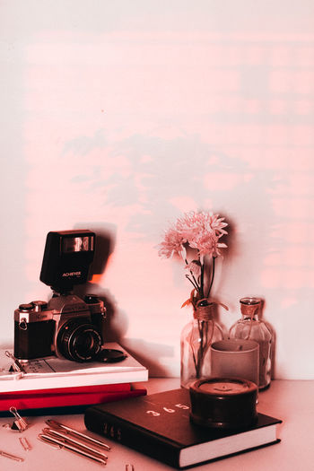 Close-up of camera in vase on table