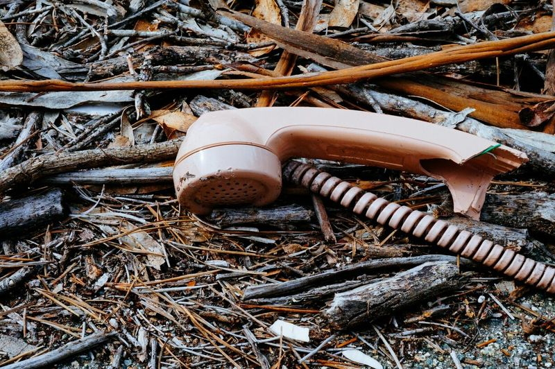 Close-up of an abandoned telephone receiver