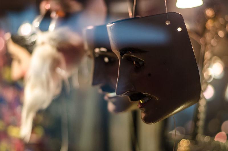 Close-up of hanging masks
