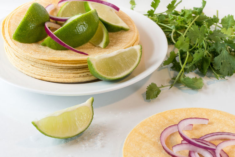 Southwest cuisine ingredients Cuisine Ingredients Cilantro Close-up Food Food And Drink Freshness Fruit Lime No People Red Onion Sea Salt Flakes Southwest  Tabletop White Background
