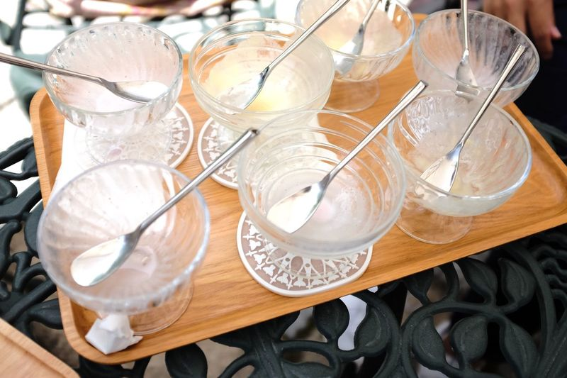 High angle view of spoons and bowl in tray on table
